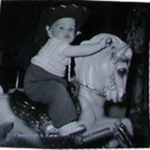 child on toy horse