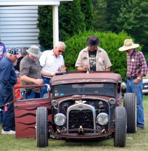 men looking at car