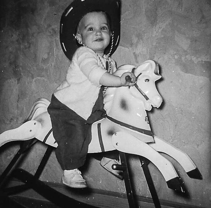 child on a rocking horse