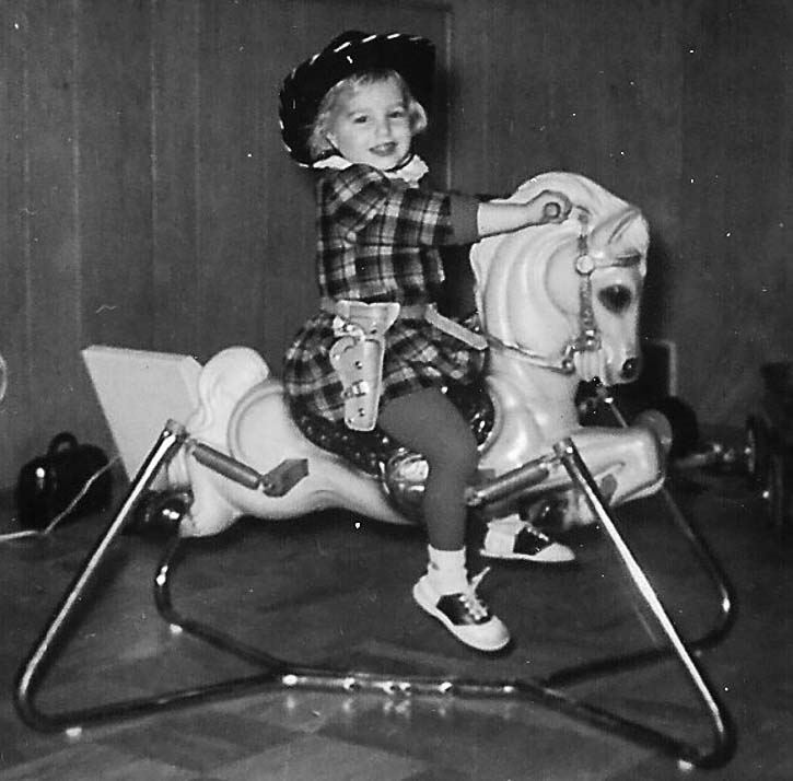 child on bouncy horse
